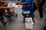 A week after the 9-11 terrorist attack on the Twin Towers and the Pentagon, a newspaper vendor sells copies of the New York Daily News with the face of Osama bin Laden and a cowboy-era outlaw's headline of 'Dead or Alive', on 18th September 2001, New York, USA. (Photo by Richard Baker / In Pictures via Getty Images)