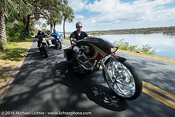 Cory Ness riding his side-by-side twin engine custom in Tamoka State Park with his father Arlen Ness and son Zach and  during the Daytona Bike Week 75th Anniversary event. FL, USA. Monday March 7, 2016.  Photography ©2016 Michael Lichter.