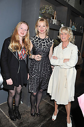 Left to right, LADY HENRIETTA STANLEY, her mother the COUNTESS OF DERBY and SUE JONES co-founder of Oka at a party to celebrate the publication of Folly de Grandeur: Romance and Revival in an English Country House by Nicky Haslam held at Oka, 155-167 Fulham Road, London on 21st March 2013.