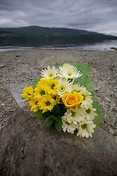 Alan Wright laying flowers at the small beach on the Loch where it happened. He was involved in the with the emergency services on Loch Lomond and  took paramedics on his boat to try and rescue the boy who drowned on Sunday.