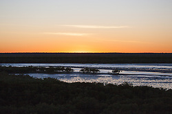 Dawn breaks over Dampier Creek in Roebuck Bay, Broome, on a spring tide.