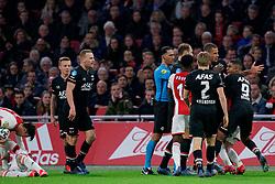 Hakim Ziyech #22 of Ajax and Ramon Leeuwin #27 of AZ Alkmaar, Myron Boadu #9 of AZ Alkmaar and Referee Serder Gozubuyuk  during the Dutch Eredivisie match round 25 between Ajax Amsterdam and AZ Alkmaar at the Johan Cruijff Arena on March 01, 2020 in Amsterdam, Netherlands