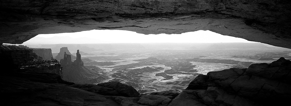 Wide arch opening with Canyonlands view