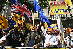 © Licensed to London News Pictures. 15/08/2021. London, UK. Protesters demonstrate outside the Indian High Commission in support of Kisaan farmers who have been in dispute over three farm acts which were passed by the Parliament of India in September 2020. The demonstration come son the day India celebrate its 75th Independence Day. Photo credit: Ray Tang/LNP
