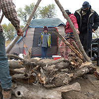 Solaris Collymore waits around camp while others cook fry bread for lunch at theDakota Access Pipeline protest camp in Standing Rock, ND Tuesday.