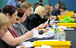 Election count staff count ballot papers for the local election at Riverside Ice & Leisure Centre in Chelmsford, Essex.