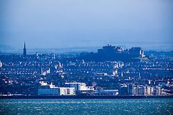 Edinburgh Castle and the River Forth coastline, as seen from the A921 near Burntisland, Fife.