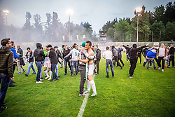 Matic Fink #17 of NK Olimpija Ljubljana and fans celebrate after winning during football match between NK Rudar and NK Olimpija Ljubljana in Round #35 of Prva liga Telekom Slovenije 2015/16, on May 14, 2016, in Stadium Ob jezeru, Velenje, Slovenia. NK Olimpija with this victory became Slovenian National Champion 2016. Photo by Vid Ponikvar / Sportida