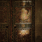 Light cast on painted old wooden doors of the Al Mamlouka hotel in Damascus, Syria