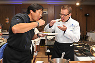Chef Ming Tsai and actor Matt Damon attend Family Reach Foundation's Cooking Live! at Ritz Carlton Battery Park on September 18, 2012 in New York City