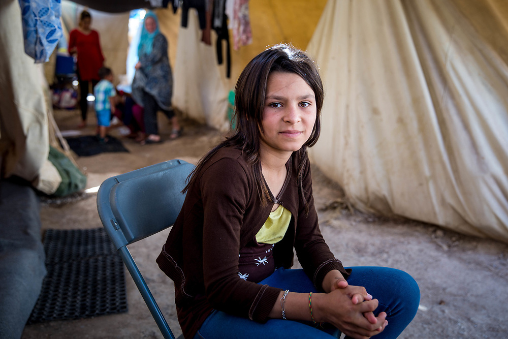 Fatimah, 13, from Aleppo, Syria. She and her family have been stranded in Greece since the Balkan borders were closed to refugees in March 2016. Ritsona Refugee Camp, Greece, July 2016.