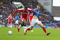 Football - 2019 / 2020 Sky Bet League One - Portsmouth vs. Gillingham<br /> <br /> Brandon Hanlan of Gillingham grabs a handful of Portsmouth's Tom Naylor shirt during the Sky Bet League One fixture at Fratton Park <br /> <br /> COLORSPORT/SHAUN BOGGUST