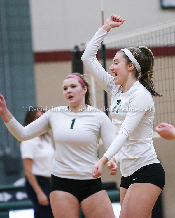 (11/7/17, HOPKINTON, MA) Hopkinton's Ivy Gogolin, right, and Amanda Gilbert reacts to winning a point during the Division 1 Central-West tournament volleyball game against Franklin at Hopkinton High School on Tuesday. [Daily News and Wicked Local Photo/Dan Holmes]