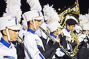 Timothy Duong, junior, prepares his flute before the marching band's halftime performance during the Milpitas High School varsity football game against Mountain View High School on Oct. 5, 2012 in Milpitas, Calif.  The Trojans would go on to win 42-7.  Photo by Stan Olszewski/SOSKIphoto.
