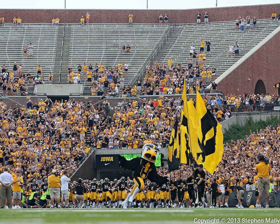 September 07 2013: The student section of Kinnick stadium shows many empty seats as the Iowa Hawkeyes take the field before the start of the NCAA football game between the Missouri State Bears and the Iowa Hawkeyes at Kinnick Stadium in Iowa City, Iowa on September 7, 2013. Iowa defeated Missouri State 28-14.