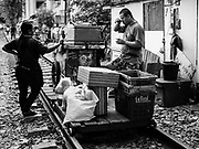 17 DECEMBER 2018 - BANGKOK, THAILAND: Fruit sellers with their cart on railroad tracks near the Sukhumvit Road tourist district in central Bangkok. According to Credit Suisse Global Wealth Databook 2018, which surveyed 40 countries, Thailand has the highest rate of income inequality in the world. In 2016, Thailand was third, behind Russia and India. In 2016, the 1% richest Thais (about 500,000 people) owned 58.0% of the Thailand's wealth. In 2018, they controlled 66.9%. In Russia, those numbers went from 78% in 2016, down to 57.1% in 2018. The Thai government disagreed with the report and said the report didn't take government anti-poverty programs into account and that Thailand was held to an unfair standard because most of the other countries in the report are developed countries in the Organisation for Economic Co-operation and Development.   PHOTO BY JACK KURTZ