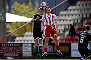 Crawley Town defender Tony Craig (24) battles for possession  with Stevenage midfielder (on loan from Brentford) Arthur Read (19) during the EFL Sky Bet League 2 match between Stevenage and Crawley Town at the Lamex Stadium, Stevenage, England on 1 May 2021.