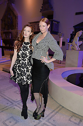 Left to right, OLIVIA GRANT and OLIVIA INGE at a private view of Alexander McQueen's Savage Beauty exhibition hosted by Samsung BlueHouse at the V&A, London on 30th March 2015.