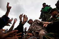 Military officers who defected from Qadaffis army addresses protesters  in Banghazi on Feb. 25, 2011.
