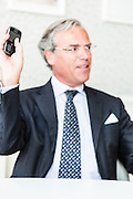 20131007 editorial portraits with an interview for Voka of their boss Michel Delbaere holding a phone. Great portraits don't have to be in focus.