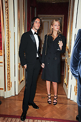 VLADIMIR RESTOIN-ROITFELD and ERIN HEATHERTON at a dinner hosted by HRH Prince Robert of Luxembourg in celebration of the 75th anniversary of the acquisition of Chateau Haut-Brion by his great-grandfather Clarence Dillon held at Lancaster House, London on 10th June 2010.