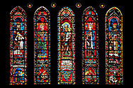 Medieval Window of the North Transept of the Gothic Cathedral of Chartres, France- Circa 1235. A UNESCO World Heritage Site. The panels depict from left to right - 1. Melchizedek with Nebechadnezzar praying to a pagan idol below 2. King David with his harp with Saul dying on his own sword below 3. Saint Anne carrying the infant Mary with The arms of the Royal House of France below 4. King Solomon with Jeroboam worshipping the idols of Dan and Bethel below, 5. Aaron with Pharaoh falling from his horse below, .<br /> <br /> Visit our MEDIEVAL ART PHOTO COLLECTIONS for more   photos  to download or buy as prints https://funkystock.photoshelter.com/gallery-collection/Medieval-Middle-Ages-Art-Artefacts-Antiquities-Pictures-Images-of/C0000YpKXiAHnG2k