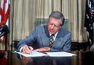 A 27MG IMAGE OF:..Jimmy Carter signs the Windfall profits Act  On May 31, 1979..Photo by Dennis Brack