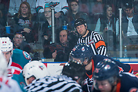 KELOWNA, CANADA - MARCH 31: Referee Chris Crich speaks to ice officials at centre ice during second period between the Kelowna Rockets and the Kamloops Blazers on March 31, 2017 at Prospera Place in Kelowna, British Columbia, Canada.  (Photo by Marissa Baecker/Shoot the Breeze)  *** Local Caption ***