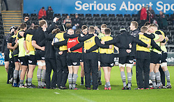 Ospreys players huddle during the pre match warm up<br /> <br /> Photographer Simon King/Replay Images<br /> <br /> European Rugby Champions Cup Round 5 - Ospreys v Saracens - Saturday 13th January 2018 - Liberty Stadium - Swansea<br /> <br /> World Copyright © Replay Images . All rights reserved. info@replayimages.co.uk - http://replayimages.co.uk