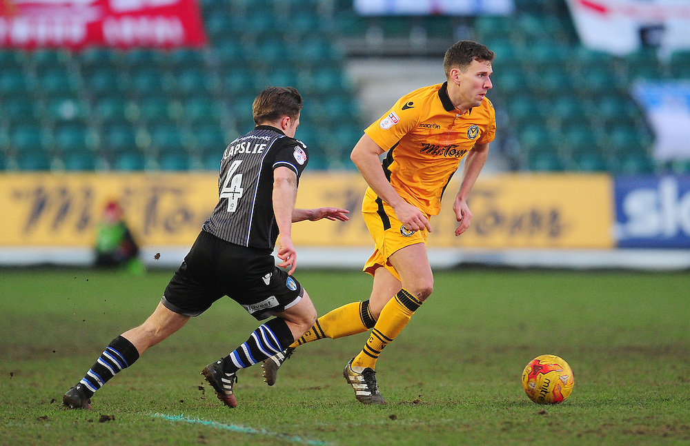 Newport County's Mark Randall under pressure from Colchester United's Tom Lapslie<br /> <br /> Photographer Kevin Barnes/CameraSport<br /> <br /> The EFL Sky Bet League Two - Newport County v Colchester United - Saturday 14th January 2017 - Rodney Parade - Newport<br /> <br /> World Copyright © 2017 CameraSport. All rights reserved. 43 Linden Ave. Countesthorpe. Leicester. England. LE8 5PG - Tel: +44 (0) 116 277 4147 - admin@camerasport.com - www.camerasport.com