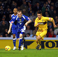Photo: Dave Linney.<br />Cardiff City v Burnley. Coca Cola Championship. 11/11/2006.The race is on for Cardiff's Willo Flood (L) and Burnley's Frank Sinclair