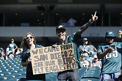 """Philadelphia Eagles fans in the stands with a sign that reads """"We Came from San Diego 2 see our birds. Fly Eagles Fly"""" during warm ups before the NFL game between the Dallas Cowboys and the Philadelphia Eagles at Lincoln Financial Field in Philadelphia on Sunday September 20th 2015. (Brian Garfinkel/Philadelphia Eagles)"""