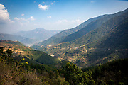 A view down the valley towards the Buri Gandaki River, on the 3rd of March 2020 in  the village of Raniswara, Ghairung, Gorkha, Nepal.  The Buri Gandaki river on the 3rd of March 2020 near Malekhu Benighat region, Nepal. This river is a tributary of the Gandaki river in Nepal and acts as a boarder for the Benighat of Dhading and Gorkha Districts. Nepal is looking to build a $2.5 billion dam on the river, the plant and its reservoir are to be located in the Dhading and Gorkha districts.