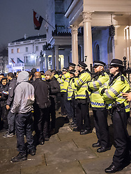 December 13, 2016 - London, London, United Kingdom - Image ¬©Licensed to i-Images Picture Agency. 13/12/2016. London, United Kingdom. Aleppo is Dying Protest. ..A row of police officers guard the doorway as over 1000 protesters gathered outside the Syrian Embassy in London...As well as voicing their anger at the current dire situation for civilians in the war torn city of Aleppo and speaking out against Bashar al-Assad's regime, Muslim prayers were held at the ''emergency demo.'' ..Picture by Pete Maclaine / i-Images (Credit Image: © Pete Maclaine/i-Images via ZUMA Wire)