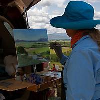 USA, Idaho, Silver Creek. Plein Air Artist Susan Perin at Silver Creek Nature Preserve, Idaho.
