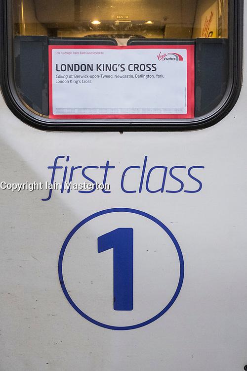 Detail of First Class door on Virgin Trains locomotive from London King's Cross on East Coast Main line  at platform at Waverley Station in Edinburgh, Scotland, United Kingdom