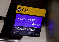 LONDON, ENGLAND - Sunday, March 18, 2018: The Cathay Pacific check in board for the Wales Football Team at Heathrow Airport as the team prepare to fly to Nanning for the 2018 Gree China Cup International Football Championship. (Pic by David Rawcliffe/Propaganda)