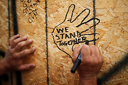 People leave personal messages on a building under renovation, remembering the victims of a shooting on Sunday evening on Danforth, Ave. in Toronto, ON, Canada, on Monday, July 23, 2018. Photo by Mark Blinch/CP/ABACAPRESS.COM