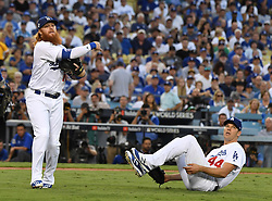 October 25, 2017 - Los Angeles, California, U.S. - Los Angeles Dodgers third baseman Justin Turner (10) throws out Houston Astros' Justin Verlander (not pictured) on a sac bunt as starting pitcher Rich Hill (44) looks on in the third inning of game two of a World Series baseball game at Dodger Stadium on Wednesday, Oct. 25, 2017 in Los Angeles. (Photo by Keith Birmingham, Pasadena Star-News/SCNG) (Credit Image: © San Gabriel Valley Tribune via ZUMA Wire)