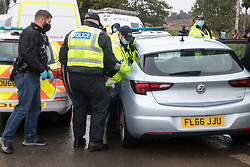 West Hyde, UK. 9th September, 2020. Hertfordshire Police officers arrest an anti-HS2 activist after invoking Section 14 of the Public Order Act 1986 to clear an area outside an entrance to the Chiltern Tunnel South Portal site for the HS2 high-speed rail link. A protest action by anti-HS2 activists, at the site from which HS2 Ltd intends to drill a 10-mile tunnel through the Chilterns, was intended to remind Prime Minister Boris Johnson that he committed to remove deforestation from supply chains and to provide legal protection for 30% of UK land for biodiversity by 2030 at the first UN Summit on Biodiversity on 30th September.