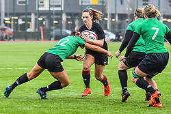 Wales women's Kerin Lake is tackled by Ireland women's Sene Naoupu<br /> <br /> Photographer Craig Thomas/Replay Images<br /> <br /> International Friendly - Wales women v Ireland women - Sunday 21th January 2018 - CCB Centre for Sporting Excellence - Ystrad Mynach<br /> <br /> World Copyright © Replay Images . All rights reserved. info@replayimages.co.uk - http://replayimages.co.uk