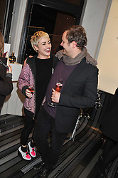 JAIME WINSTONE and NICHOLAS KIRKWOOD at a party to celebrate the launch of a limited edition shoe The Chambord in celebration of Nicholas Kirkwood's partnership with Chambord black raspberry liqueur, held at the Nicholas Kirkwood Boutique, 5 Mount Street, London on 12th December 2012.