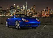 Porsche Boxster with New York City skyline.