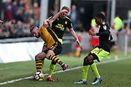Dan Butler of Newport County (l) is challenged by Brad Halliday of Cambridge Utd . The Emirates FA Cup, 2nd round match, Newport County v Cambridge United at Rodney Parade in Newport, South Wales on Sunday 3rd December 2017.<br /> pic by Andrew Orchard,  Andrew Orchard sports photography.