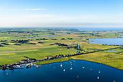 Nederland, Noord-Holland, Amsterdam (Landelijk Noord), 13-06-2017; Durgerdam aan de Durgerdammerdijk, dijkdorp gelegen aan het IJmeer (onderdeel van het IJsselmeer). De dijk staat op de nominatie om verstrekt te worden, bewoners en actievoerders vrezen aantasting van de monumentale dijk en verlies culturele waarden.<br /> Durgerdam on the Durgerdammerdijk, village on dike located at the IJmeer (part of the IJsselmeer). The dike is nominated to be reinforced, residents and activists fear losing the monumental quality of the dike and losing other cultural values.<br /> luchtfoto (toeslag op standaard tarieven);<br /> aerial photo (additional fee required);<br /> copyright foto/photo Siebe Swart
