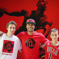 12 July 2013: Chicago Bulls superstar Derrick Rose poses with fans in Adidas' D Rose place during Adidas' D Rose tour,  in Paris, France.
