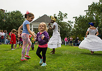 Children join SambaViva for the Brazilian Baiana dance at Rotary Park during the Multicultural Festival on Saturday.  (Karen Bobotas/for the Laconia Daily Sun)
