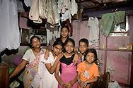 Anandi Anand Maraye and her family.  Dharavi, Mumbai, India