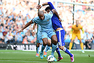 Chelsea's Diego Costa grapples with Vincent Kompany of Man city.  Barclays premier league match, Manchester city v Chelsea at the Etihad stadium in Manchester,Lancs on Sunday 21st Sept 2014<br /> pic by Andrew Orchard, Andrew Orchard sports photography.
