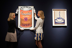 © licensed to London News Pictures. London, UK 21/06/2013. 'Colored Campbell's Soup Can' by Andy Warhol (left) estimated to be sold for £2,250,000-3,250,000 and Cup of Coffee' by Roy Lichtenstein (right) estimated to be sold for £1,500,000-2,000,000 in Christie's upcoming Post-War & Contemporary Art Evening Auction which will take place on June 25, 2013. Auction features with works by Basquiat, Doig, Liechtenstein and Warhol and total estimate is £56-72 million. Photo credit: Tolga Akmen/LNP